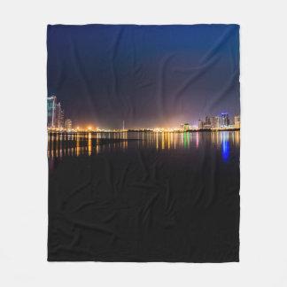 City by ocean fleece blanket