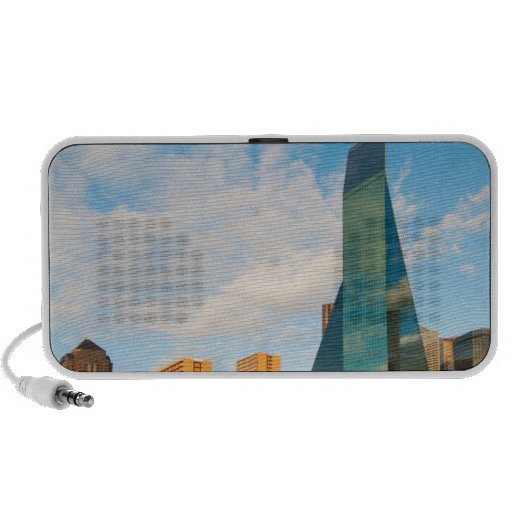 city skyline, a landmark office tower, completed notebook speakers
