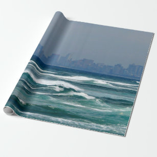 City Skyline behind the waves of the ocean Wrapping Paper