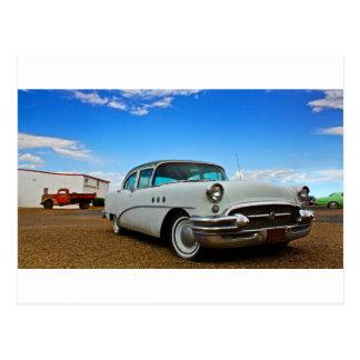 Classic car full of retro chrome postcard