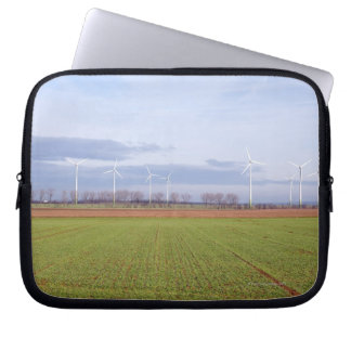 Clean energy by many wind turbines on fields. laptop sleeve