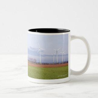 Clean energy by many wind turbines on fields. Two-Tone coffee mug