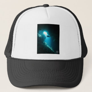 Clear blue cave and fish trucker hat