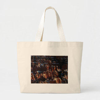 cliffs of the red rock of snow large tote bag