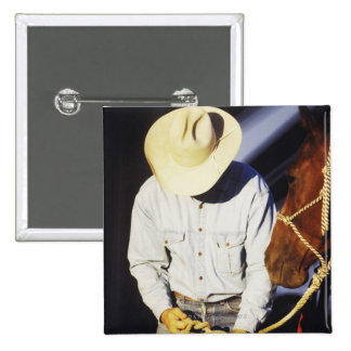 Close-up of a cowboy tying a rein 15 cm square badge