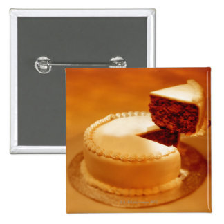 close-up of a cut piece of cake being taken out pinback buttons