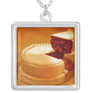 close-up of a cut piece of cake being taken out pendant