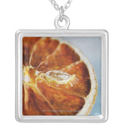 Close-up of a dried slice of lemon custom jewelry