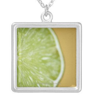 Close-up of a lemon slice square pendant necklace