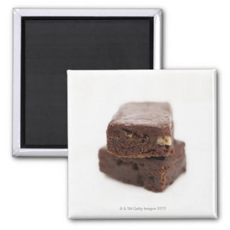 Close-up of a pile of two chocolate brownies on magnet