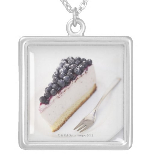 Close-up of a slice of blueberry cheese cake custom jewelry