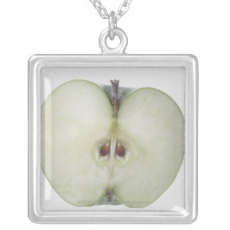 Close-up of a sliced granny smith apple pendant