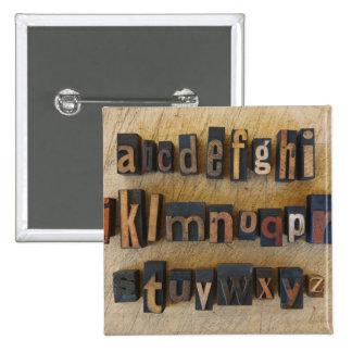 Close up of alphabet on letterpress 15 cm square badge