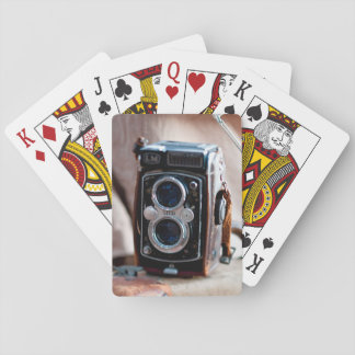 Close-up of an antique camera playing cards