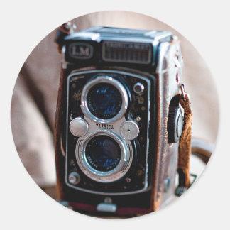 Close-up of an antique camera round sticker