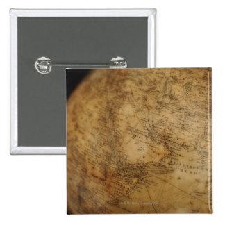Close up of antique globe 3 15 cm square badge