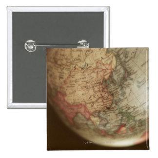 Close-up of antique globe 15 cm square badge