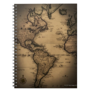 Close up of antique world map notebook
