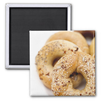 Close-up of assorted bagels on a plate magnet