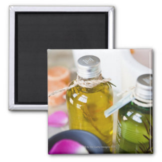 Close up of bottles with massage oils square magnet