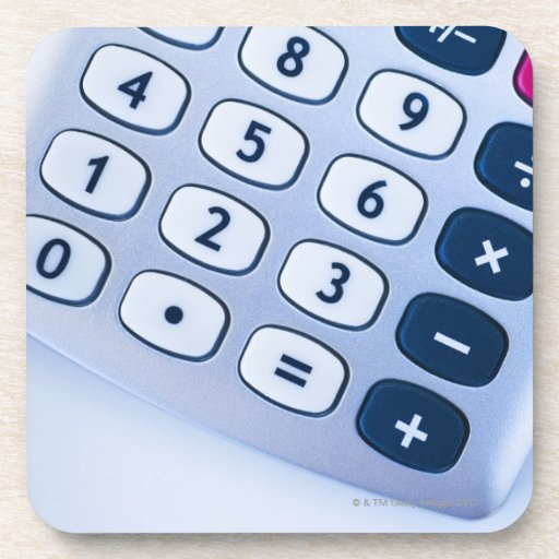 close-up of calculator buttons beverage coasters