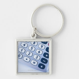 close-up of calculator buttons key chain