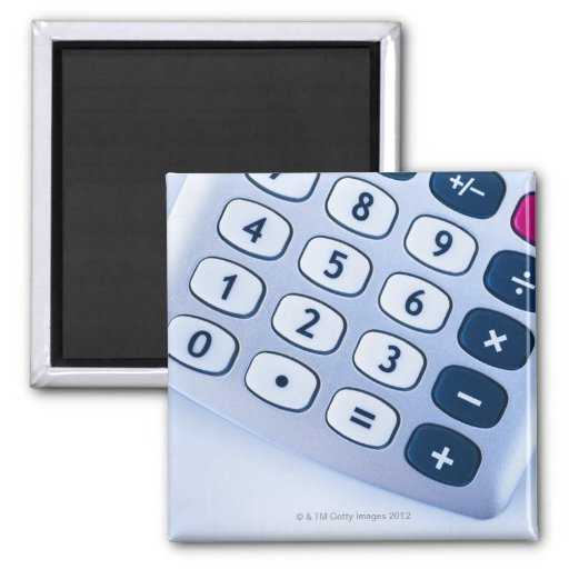 close-up of calculator buttons fridge magnets