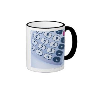 close-up of calculator buttons mugs