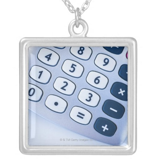 close-up of calculator buttons custom jewelry