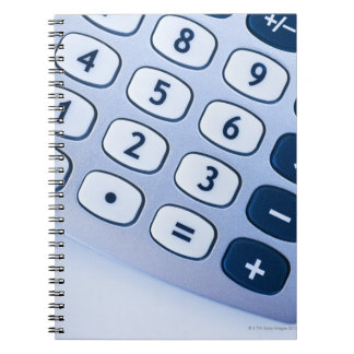 close-up of calculator buttons note books