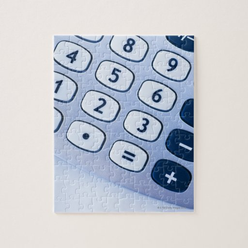 close-up of calculator buttons puzzle