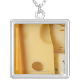Close-up of cheese slices square pendant necklace