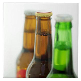 close-up of colored bottles of beer ceramic tile