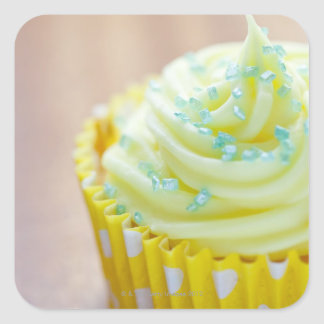 Close up of cup cake showing decoration square sticker