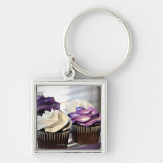 Close-up of cupcakes with selective focus on Silver-Colored square key ring