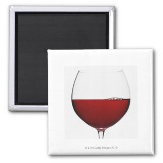 Close up of glass of red wine on white magnet