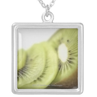 Close-up of kiwi slices necklaces