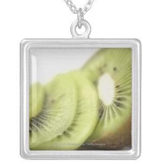Close-up of kiwi slices square pendant necklace