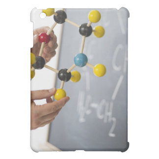 Close-up of man's hands holding molecule model, cover for the iPad mini