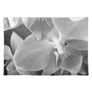 Close up of orchid blossoms in gray scale placemat