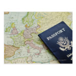 Close-up of passport lying on European map Postcard