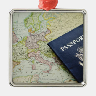 Close-up of passport lying on European map Silver-Colored Square Decoration