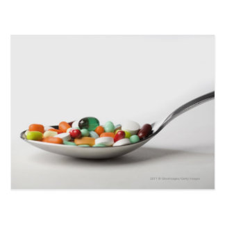 Close-up of pills in a spoon postcard