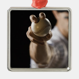Close up of pitcher holding baseball metal ornament