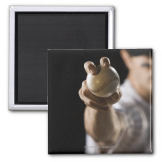 Close up of pitcher holding baseball square magnet
