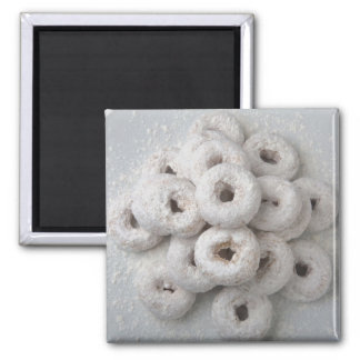 Close-up of powdered doughnuts in a plate magnet