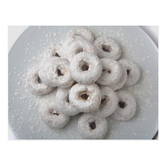Close-up of powdered doughnuts in a plate postcard