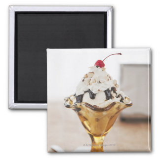 Close up of sundae with cherry on top magnets