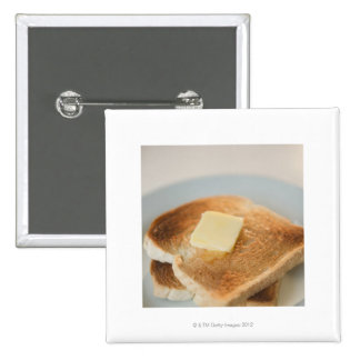 Close up of toasts with butter on plate 15 cm square badge