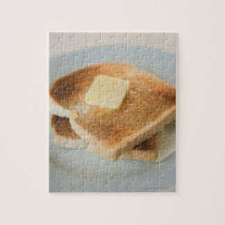 Close up of toasts with butter on plate jigsaw puzzle